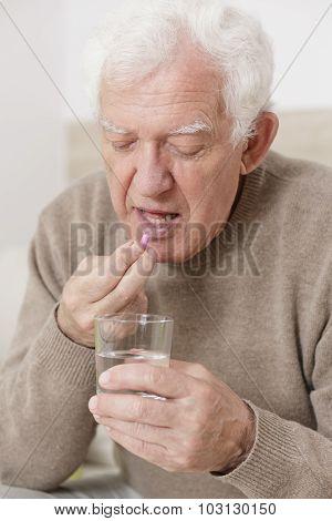 Senior Male Taking Pill