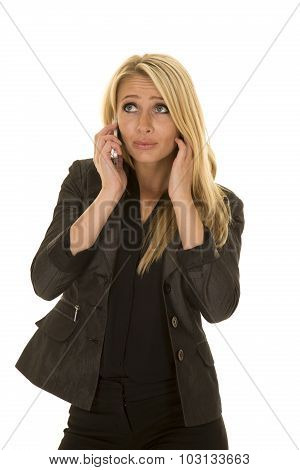 Blond Woman In Black Business Attire Talk On Phone Look Up