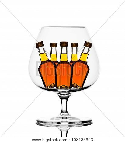Back lit glass with little cognac bottles inside