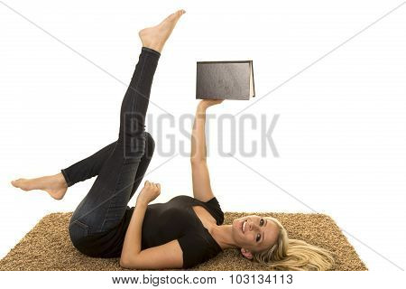 Woman Reading Wearing Black Lay On Back Hold Book And Legs Up