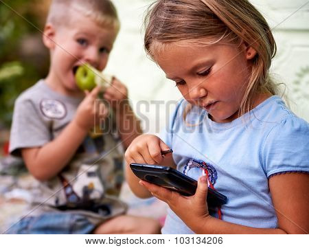 Children Play With Smartphone