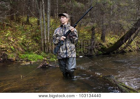 Woman Hunter With Gun On The River