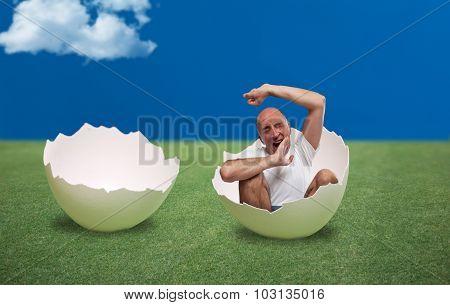 Man waking up inside an egg