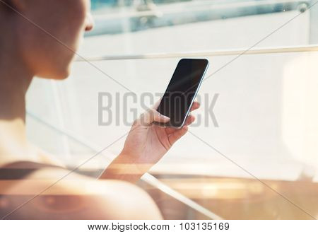 Mock up of girl using her smartphone in the city