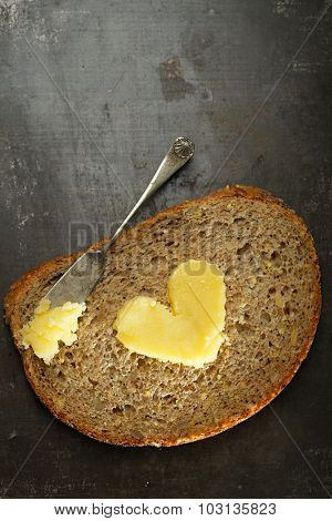 ghee or melted butter in heart shape on wholemeal bread
