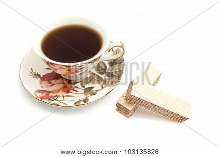 Pair Of Wafers And Cup Of Tea On White