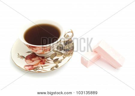 Sweet Paste And Cup Of Tea On White