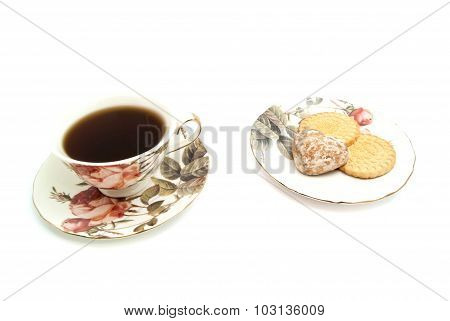 Cup Of Tea And Different Sweets On White