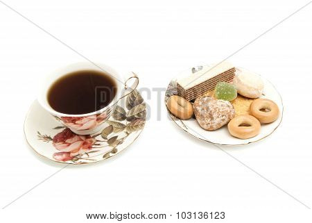 Different Sweets And Mug Of Tea