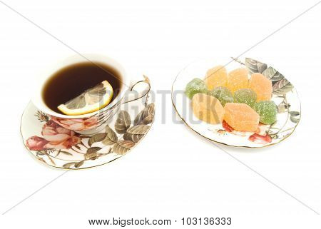 Cup Of Tea With Lemon And Fruit Candies