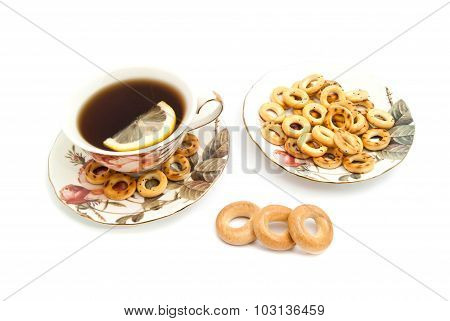 Different Bagels And Tea With Lemon