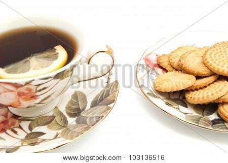 Mug Of Tea With Lemon And Some Cookies