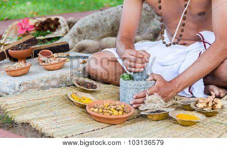 Man Preparing Ayurvedic Medicine i