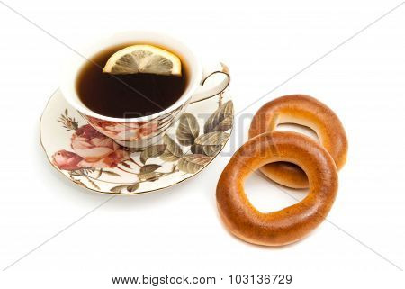 Tea With Lemon And Two Bagels On White