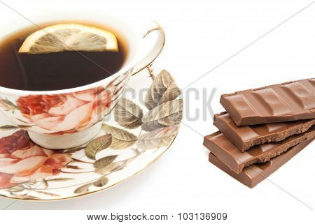 Mug Of Tea With Lemon And Chocolate