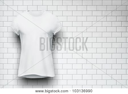 White tshirt isolated on the wall of bricks background