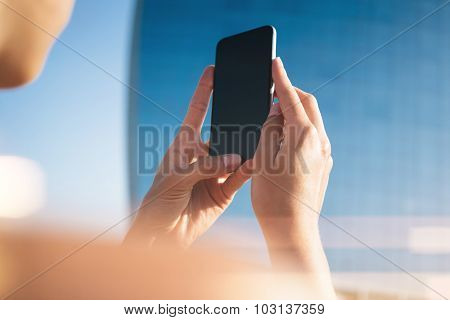 Mock up of girl making photo on her smartphone