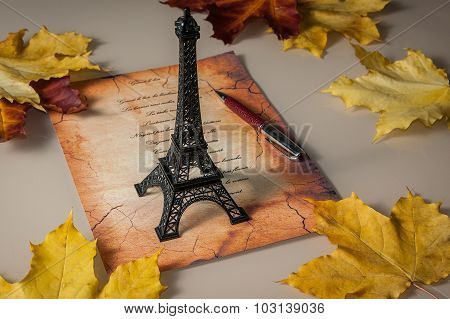 Statuette Of Eiffel Tower, Yellow Leaves, The Verse In French, A