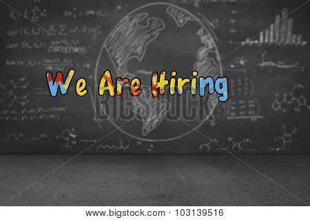 we are hiring against white graphics on black wall