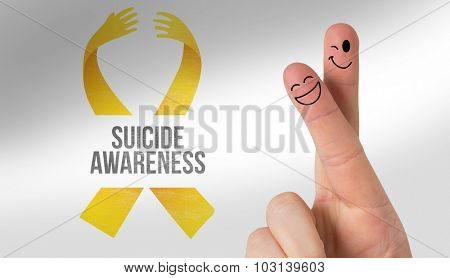 Fingers smiling against suicide awareness message