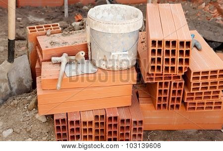 Brick and construction tools in the work