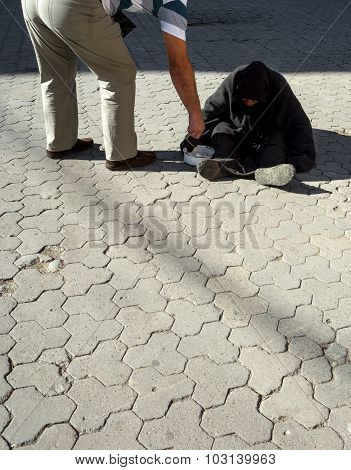Man Gives Alms To Beggar Old Woman