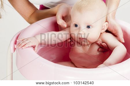 portrait of baby during bathing
