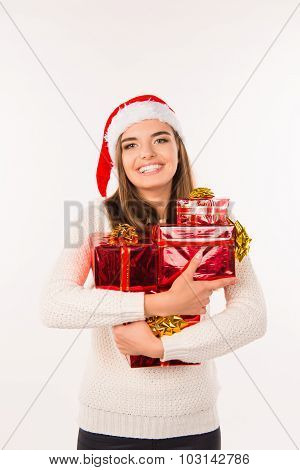 girl with gifts for Christmas on a white background