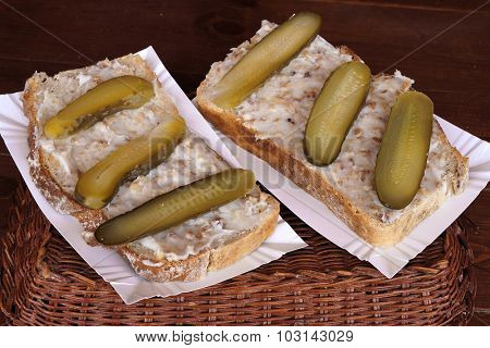 Sandwich with  lard and pickled cucumbers. Fast food.