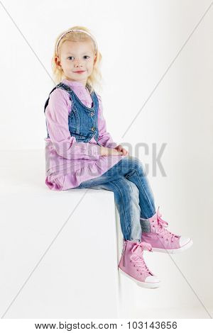 sitting little girl wearing jeans