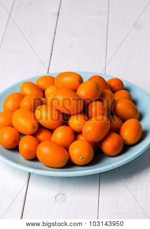 Delicious mandarin on the wooden table