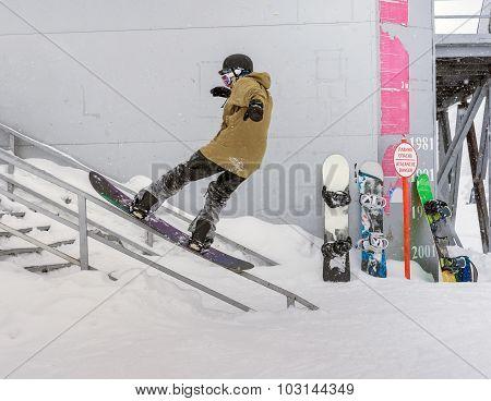 Snowboarder On Railing