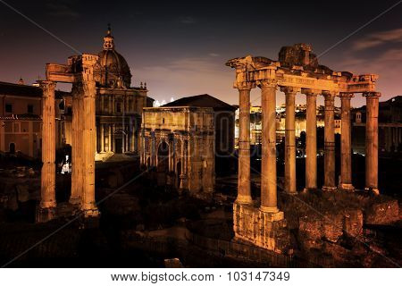The Roman Forum, Italian Foro Romano in Rome, Italy at night. Ruins of Roman ancient city.