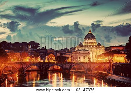 St. Peter's Basilica in Vatican City and Ponte Sant'Angelo bridge over Tiber river in Rome, Italy in the evening. Vintage, retro tone.
