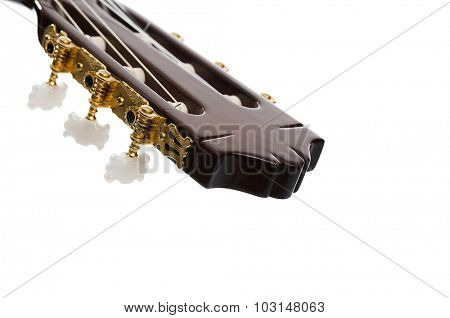 Close up of a classical guitar's tuning pegs with space for your text.