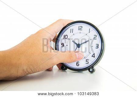 Hand Holding Alarm Clock