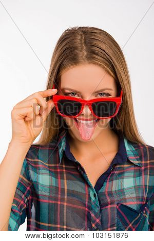 Funny Cute Girl With Glasses Showing Her Tongue