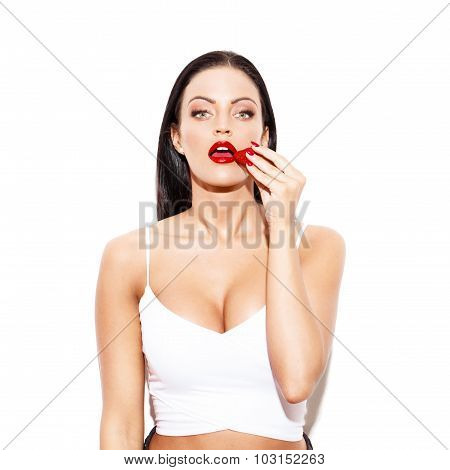 Sexy Brunette Woman Eating Strawberry