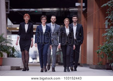 young business people team walking, group of people on modern office hall interior