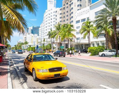 MIAMI,USA - AUGUST 5,2015 : Art Deco hotels and traffic on a sumer day at Collins Avenue in Miami Beach