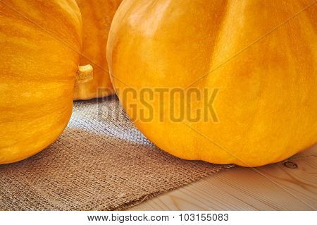 Autumn Pumpkins On A Wooden Background In A Rustic Style