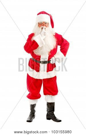 Santa - Claus Looks Intently Through His Glasses Directly At The Camera And ?alls For Silence With H