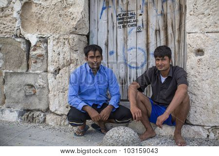 KOS, GREECE - SEP 28, 2015: Unidentified refugees. Kos island is located just 4 kilometers from the Turkish coast, and many refugees come from Turkey in an inflatable boats.