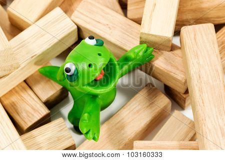 Green Monster On Wooden Bars
