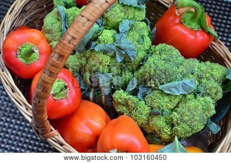 broccoli and sweet peppers in a basket