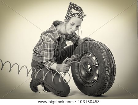 Black And White Vintage And Young Woman Inflates A Car Tire