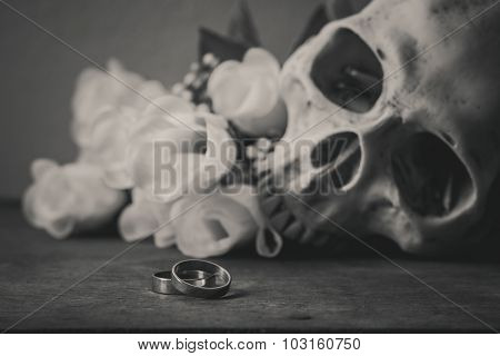 roses on wood table Forever Love concept photography focused at rings on wood table