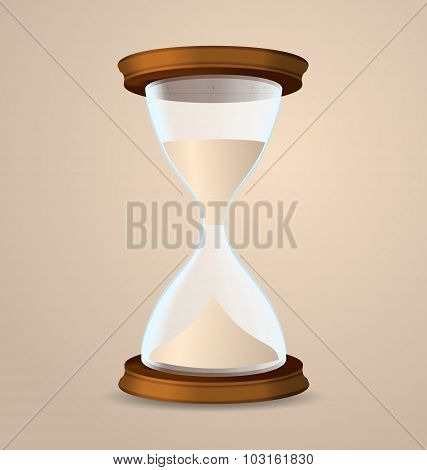Vintage hourglass isolated on beige background