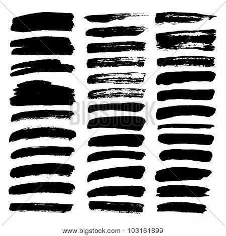 Big Set Of Thin Smears Of Ink Isolated On A White Background