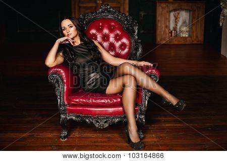 Pretty young brunette in a little black dress